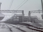 26057 passes through a bleak and inhospitable Penistone Station with a return empty for Wath in January 1966