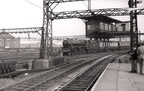 London Road 1957, 44716 enters the station. This shows the wartime protection built over the signal box.