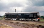 English Electric Type 4 No.10203 seen broadside at Eastleigh Works, gleaming black with silver bogies, largest in power of the Southern trio, black storm clouds above, superb. 1954