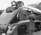 Miss A.Crawford cutting the tape in front of the first northbound working of The Capitals Ltd by A4 60010 'Dominion of Canada'.at Kings Cross.