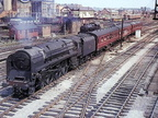 Now preserved, the unique Riddles BR Standard Class 8 4-6-2 Pacific No 71000 'Duke of Gloucester' on a three coach train heading north - Rugby ~ 1950's.