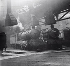 Ex R.O.D. 2-8-0 No. 3018 and 6904 Charfield Hall inside Tyseley in 1956.