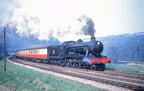 Ex GWR County Class 4-6-0 No.1004 near Sapperton tunnel with a class 2 stopping train - 1956