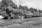 Longmoor  14th April, 1949 and depicts WD 2-10-0 'Kitchener' in blue livery but still bearing its WD number of 73797. The loco was an NBL product dating from August 1945 and it subsequently acquired the number 601 in 1