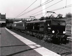 April 24th 1955  Looking immaculate though merely dressed in plain black with simple red lining, EM2 Co-Co No. 27002 glides effortlessly through the station with an Up Express. A Gresley teak bodied third class carriage