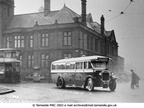 Bus passing by the Hyde town hall - 1930s.