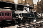 ..North British built Stanier 4P 2-6-4T 42601 stands in Platform 3 at Birmingham New Street with a southbound (up) local to Coventry 1958.