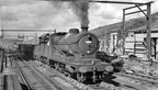 Class O4 2-8-0 with a long train it has brought up from Manchester enters Woodhead station,
