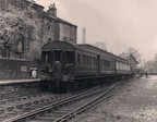 Delph station circa 1955 and the 'Delph Donkey', as locals called it, waits to depart. Usually worked by a Newton Heath Stanier Class 2 2-6-2T.