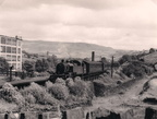 'Delph Donkey'. Ex.LMS Fowler Class 3 2-6-2T No.40056 passing Measurements Halt in the early Fifties with a train from Delph.