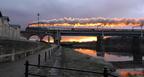 The Royal Scot steam train powering over Carlisle bridge Saturday evening