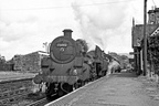 75002 and 76038 await the passage of an up train at Cemmaes Road station on 3rd September 1966