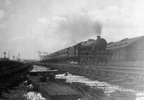 train passing Longsight sheds the old Excursion platform is on the left I think this became the F.L.T