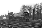 34064 'Fighter Command' was the standby engine for the Winston Churchill funeral train on 30-1-65 and waits patiently in the down siding at the London end of Staines Central station.