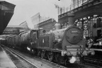 30667 and 34060 25 Squadron on a stone train with 32697 and 32135 banking at Exeter St. Davids in 1954.
