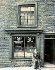 HYDE - Alfred Wooley outside his grocery store on Stockport Road, Gee X