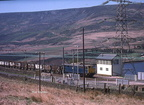 76047 heads east past Torside signal box with a train of scrap metal on 9.5.1978.