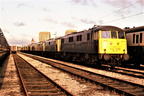 The entire 25kv Class 82   AL2 bar one - lined up withdrawn in Longsight yard. ..1980's.