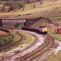 020-The final death throes of the Woodhead Route. On 31st May 1987, 47354 is seen heading westwards with a train of recovered sleepers near Torside crossing||<img src=./_datas/9/o/6/9o6rl289yj/i/uploads/9/o/6/9o6rl289yj//2016/04/24/20160424203455-b1706f9d-th.jpg>