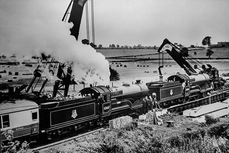 62666 Zeebrugge and No.62667 Somme are working a special train to the Farnborough Air display in September 1955.