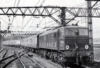 21-Class EM2 No. 27004 un-named at the time,departs London Road, Manchester station with a Sheffield bound express on the Woodhead route in about 1955