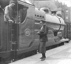 Old GCR- BR shot of a lady guard at Marylebone during WW1. The loco is PURDON VICCARS.