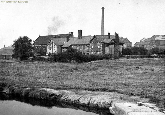 Dukinfield Old Hall with the power house chimney in the background