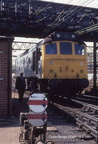 25235 entering the holding sidings at Guide Bridge with the once familiar 'double dolly' in the foreground.1981