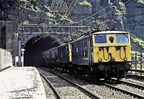 On 25th July 1980,1500 d.c. Class 76's Nos.76008(leading) and 76021 exiting the Western Portal of the Woodhead Tunnel.