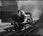 8737 leaving the tunnel and entering Snow Hill Station in 1959. Photo by M. Mensing