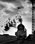 An Air Express, the Imperial Airways latest machine, flies over the Flying Scotsman at Welwyn, Hertforshire