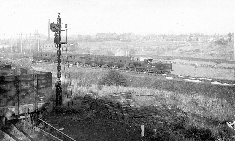 A rare picture indeed! Taken from Guide Bridge North signal box, what looks like an L&Y A class 0-6-0 runs on the line from Stalybridge to Denton Junction that passed under the Woodhead line.