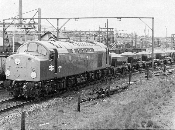 . 40114 reverses a ballast train into the sidings. 1977