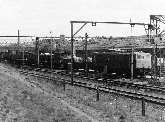 . 76003 couples up to a steel train at Dewsnap Sidings 1977