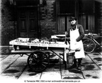 HYDE - W. Cheetham Fishmonger showing Jeffrey Cheetham taken outside Top House, Gair Street, Flowery Field 1950.