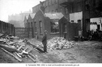 HYDE - Hyde Flood. A policeman watching workmen repair damage - 1906