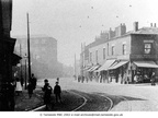 HYDE - Manchester Road, on corner of Newton Street. Showing Oultons Shop, Greencroft Mill, tramlines and children (1910
