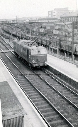 Godley station 6.9.1958 with light engine 26027 passing.