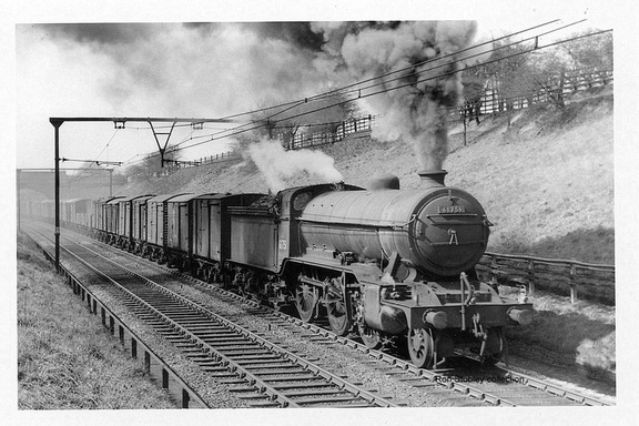 K2 61751 makes a stirring sight as it tackles the incline up to Woodhead with a string of wagons.1954