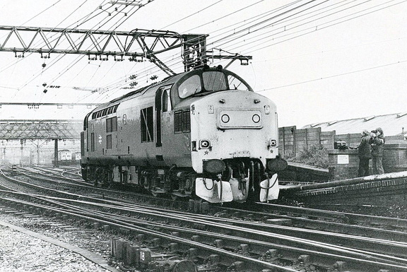 37193, fitted with snowploughs, leaves the holding sidings Guide Bridge 1981