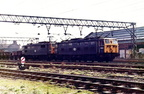 July 1979 and Class 76 No's 76010 and 76016 have arrived at Dewsnap Sidings,Dukinfield with a train of empty mineral wagons.