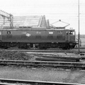 76020 runs light past the sidings towards Guide Bridge past Dukinfield Wagon Works 27-04-1977