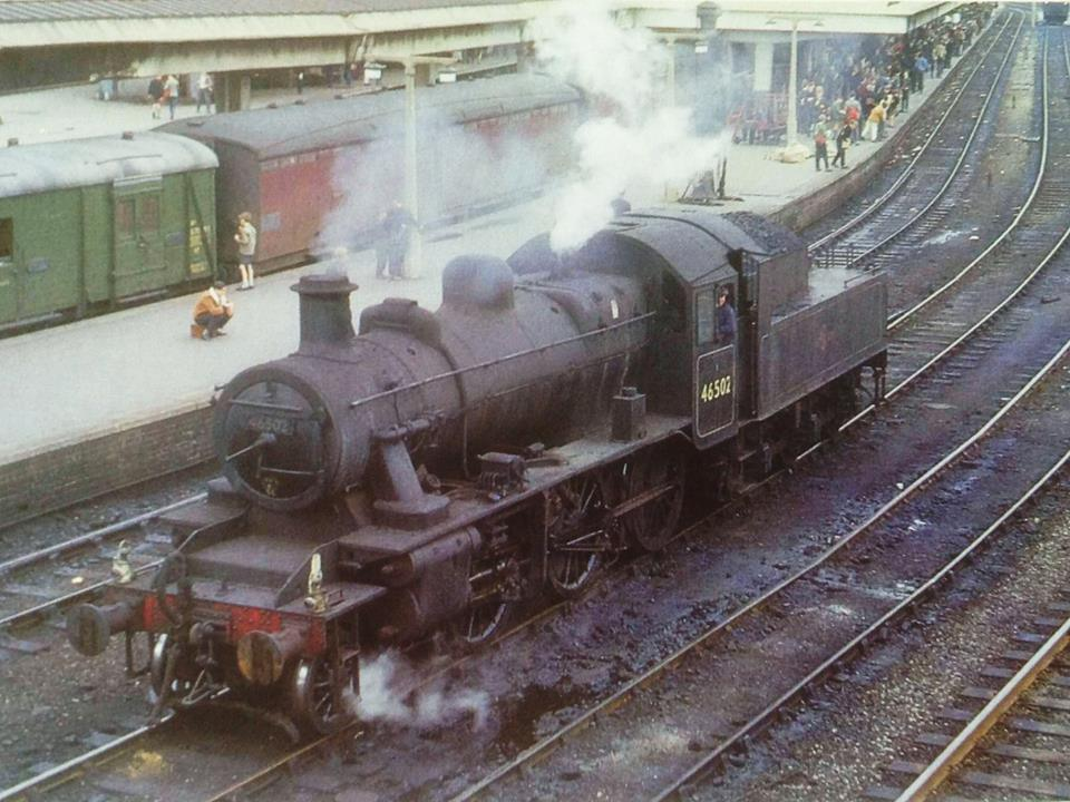 Crowds gather on Derby station on one of the great works and depot open days, August 25th 1962. Derby-allocated Ivatt ' 2MT' 2-6-0 No. 46502 is on station pilot duty.